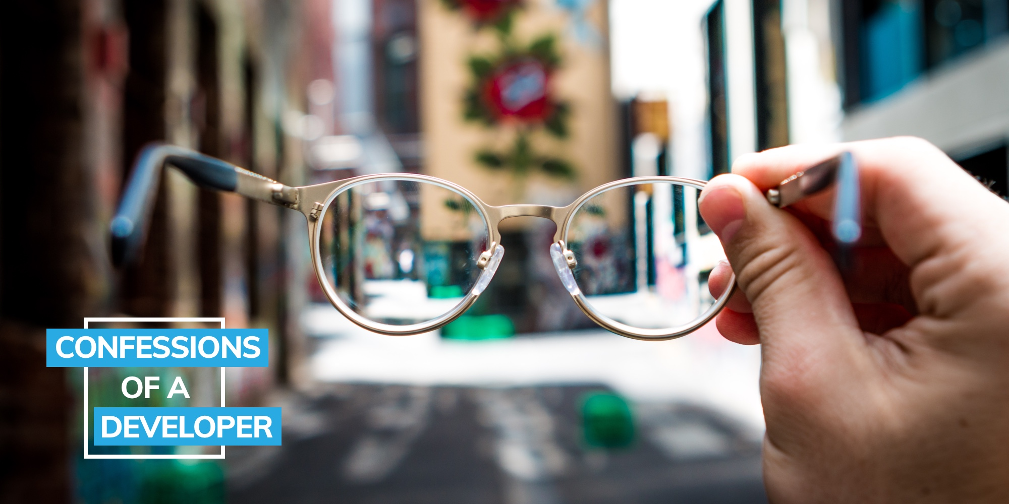 Blog image of looking through a pair of glasses for confessions of a developer