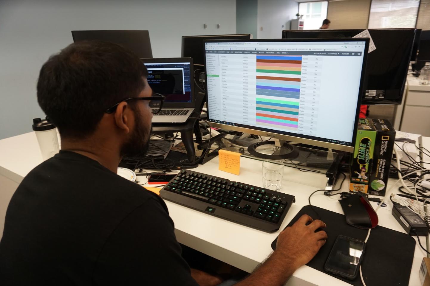 TTT software developer working on code for hackathon