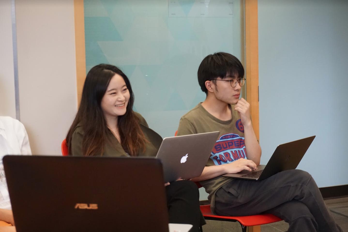 TTT team members amused by hackathon presentations