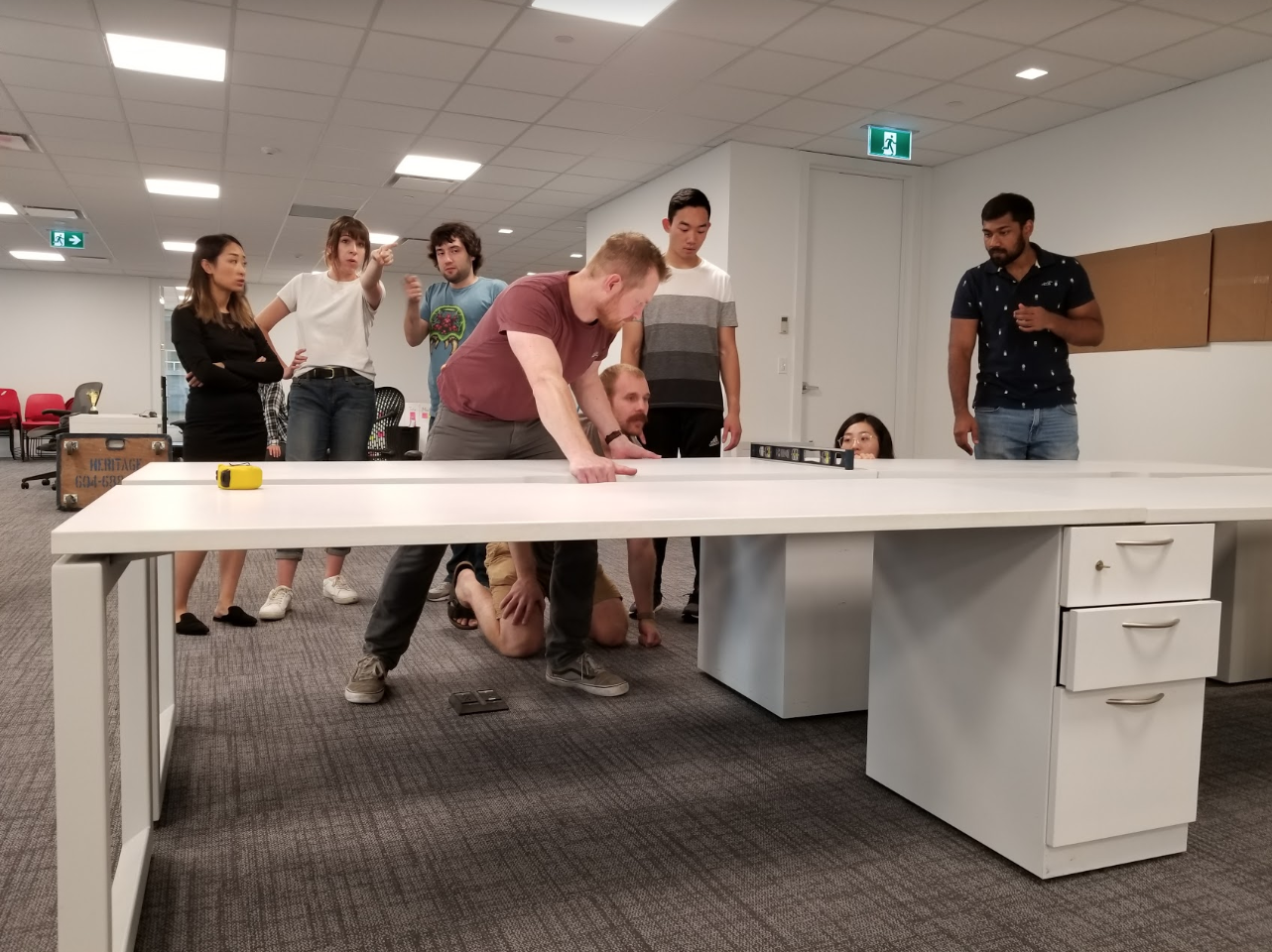 group of people assembling a desk