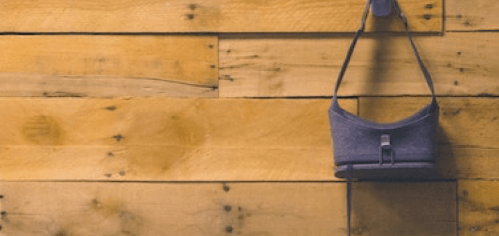 Picture of a google daydream VR goggle hanging on a wooden backdrop