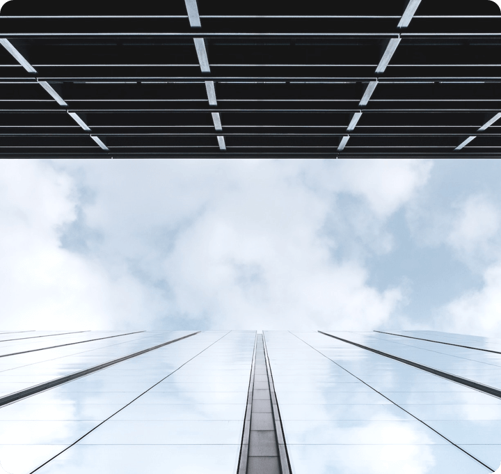 Picture of the sky between two tall buildings looking upwards. Picture for enterprise solutions