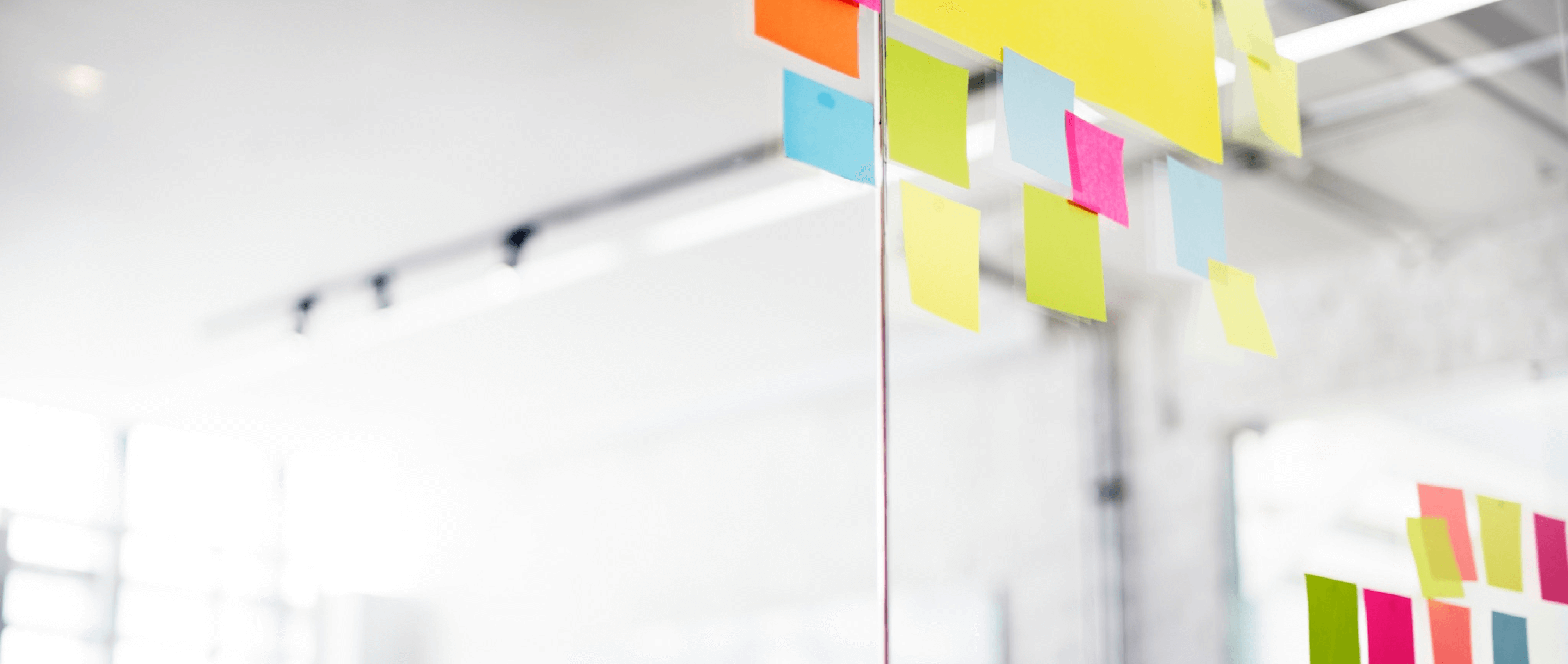 Picture of colourful post-it notes stuck onto a glass window