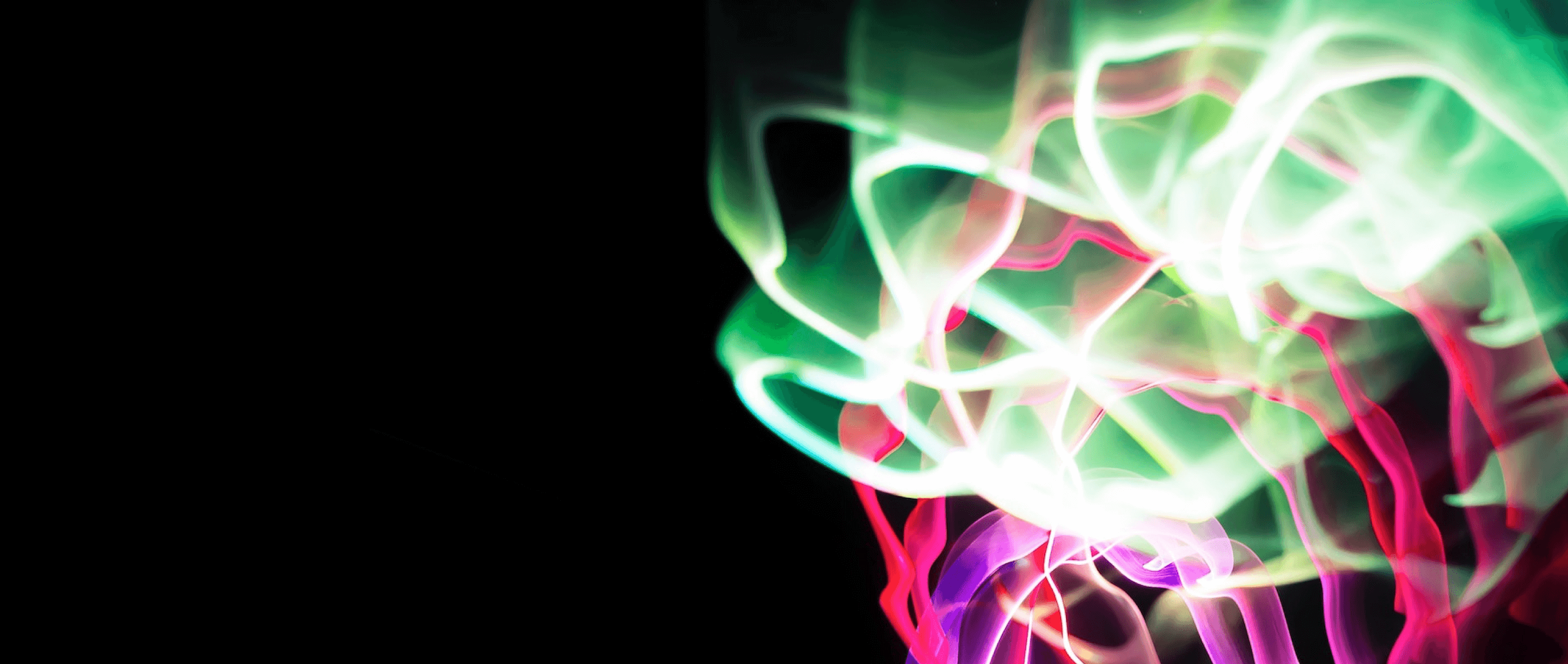 Image of cool light effects with different colours on black background