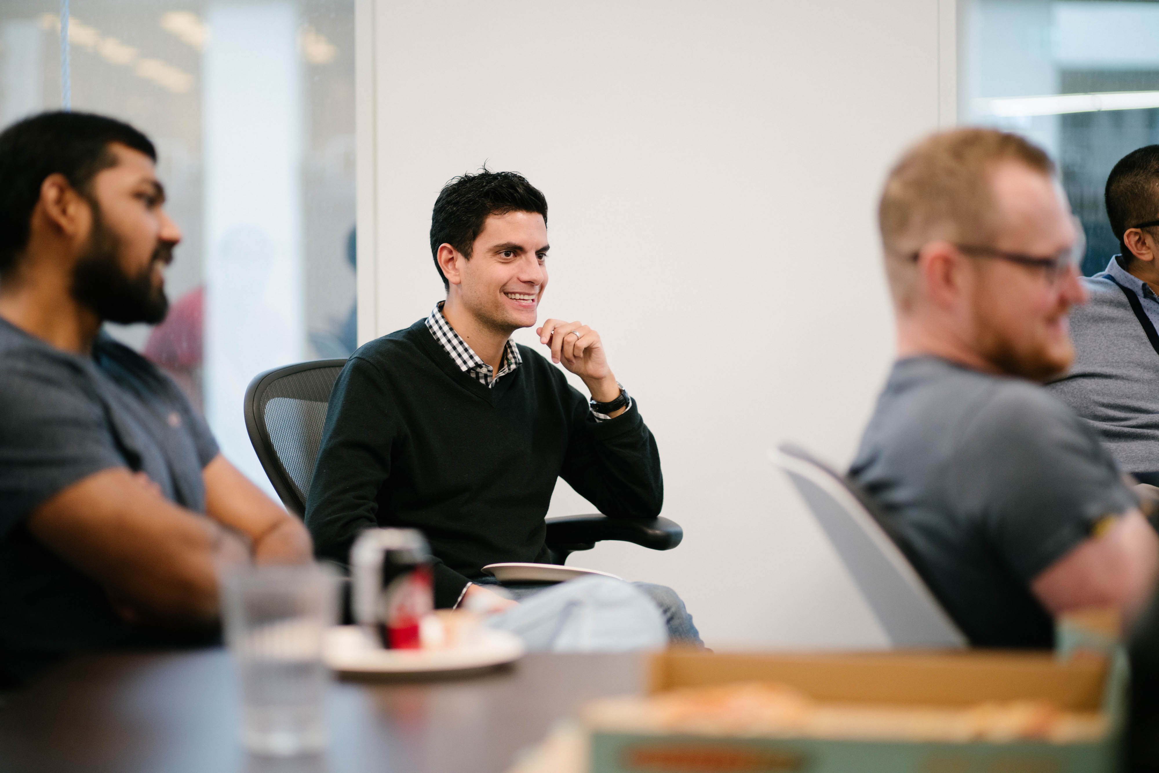Smiling business man in the middle of meeting
