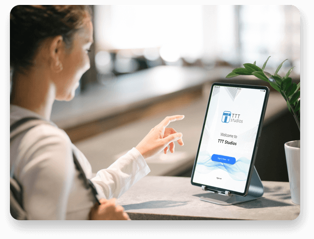 Visitor interacting with an AI facial recognition receptionist at the front desk