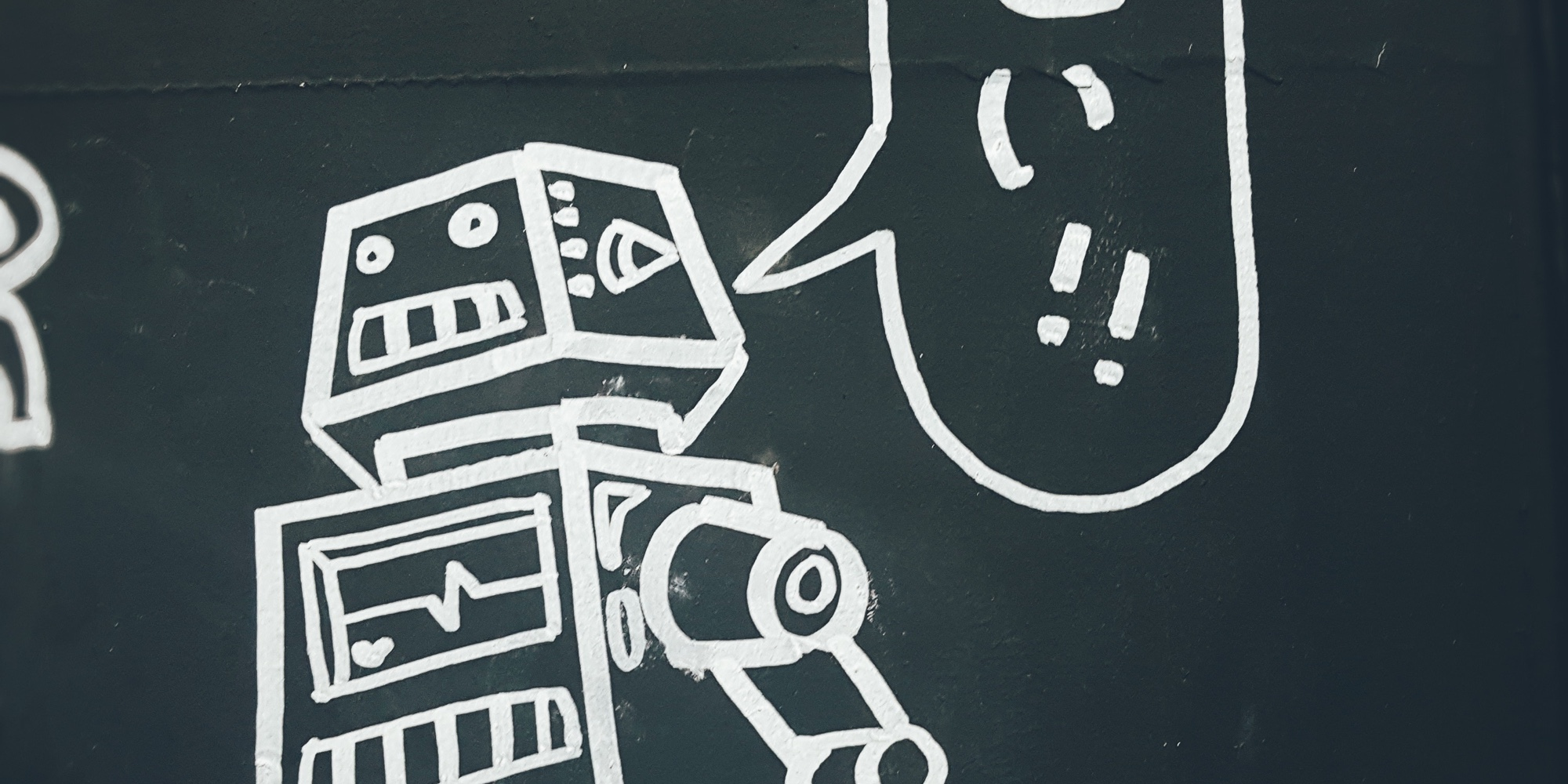Picture of a robot with a speech bubble drawn on a chalkboard