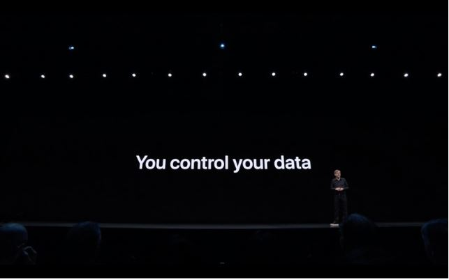 "Slide from the WWDC 2019 keynote presentation with white text on a black backdrop that says ""You control your data."""