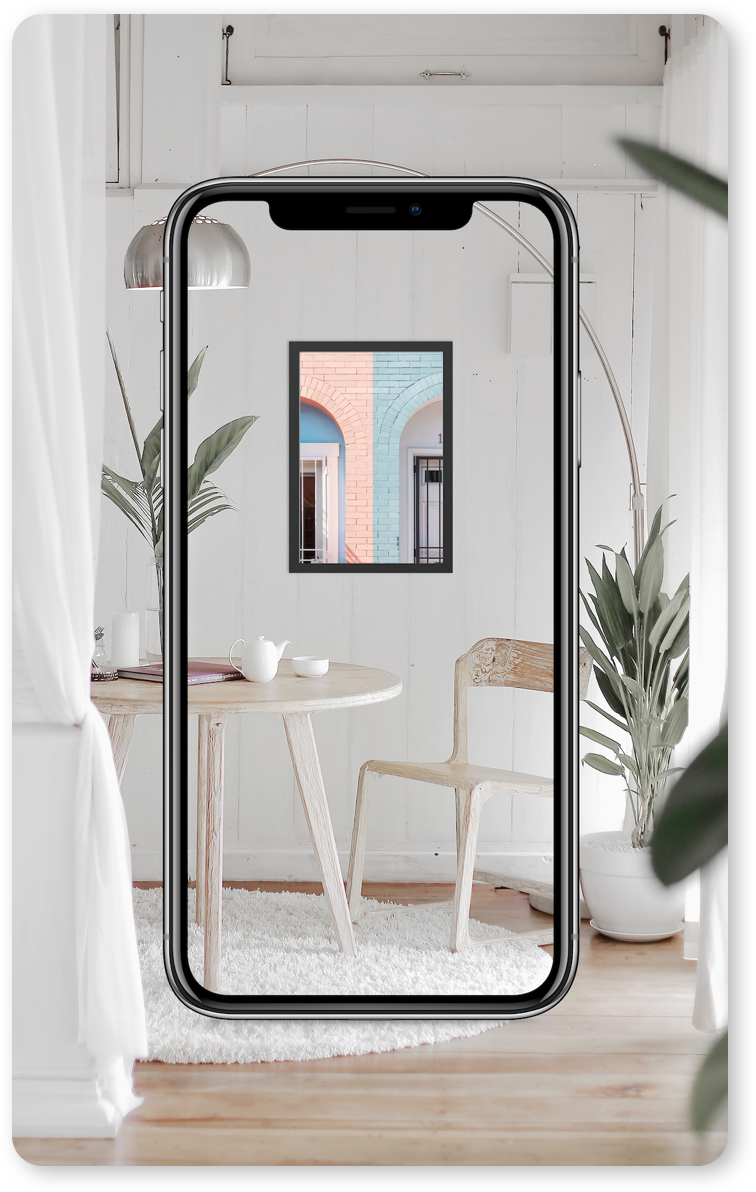 AR app on phone showing mockup of picture on a living room wall before purchase
