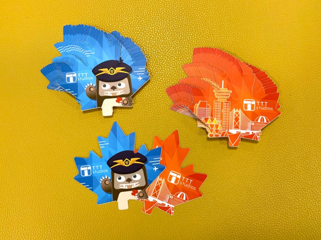 Blue and red maple-leaf-shaped TTT stickers for Canada Day