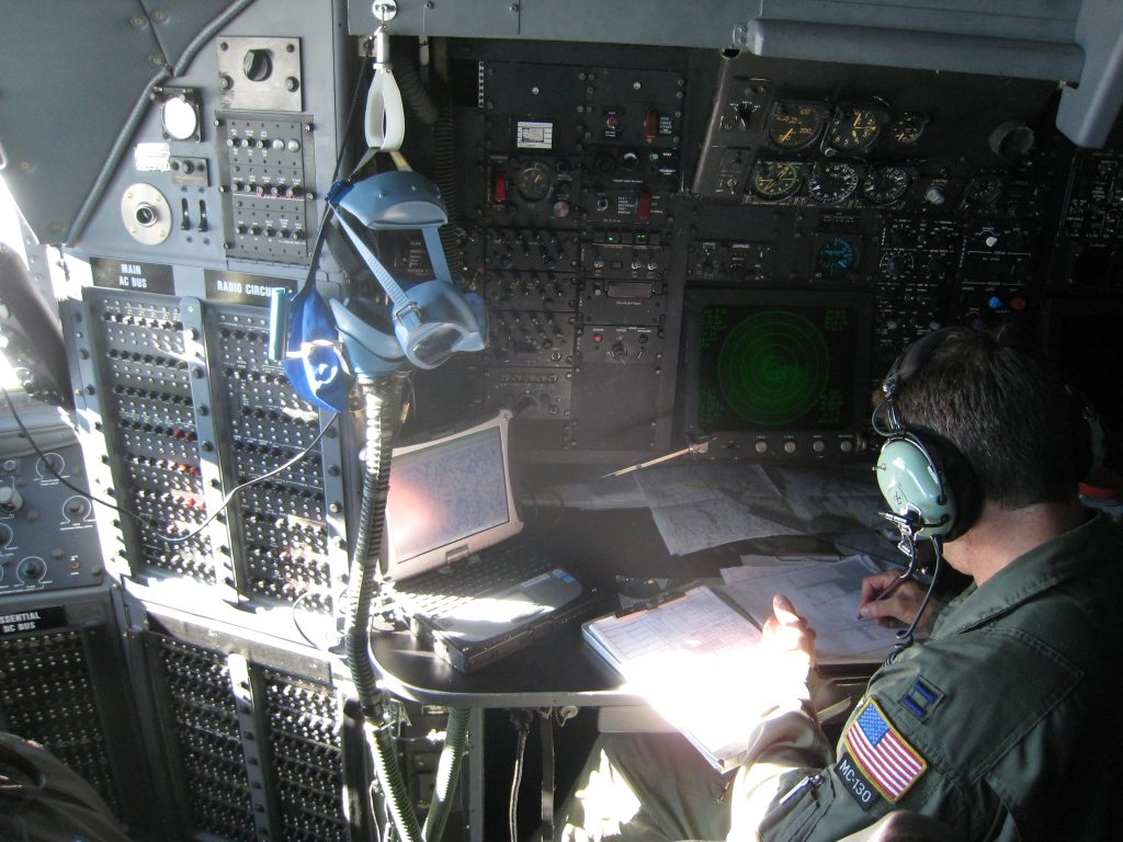 flight crew member sitting in the flight deck of MC-130 Hercules aircraft