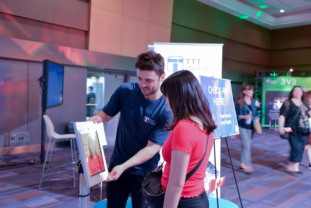 Photo of TTT's entrepreneur-in-residence, Nick, helping a lady take a selfie for our facial recognition demo