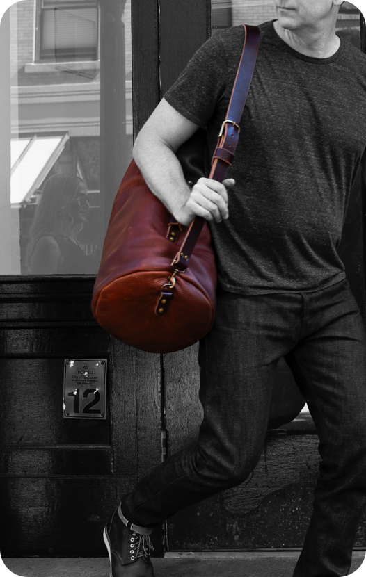 black and white picture of Man with red luxury bag