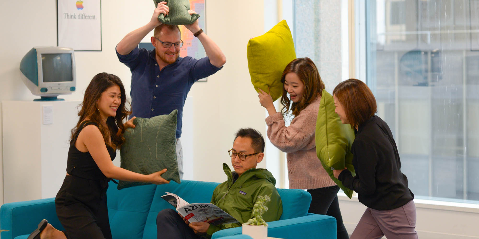 """TTT design team holding a goofy pose for """"how to grow a high-functioning design team"""" blog banner"""
