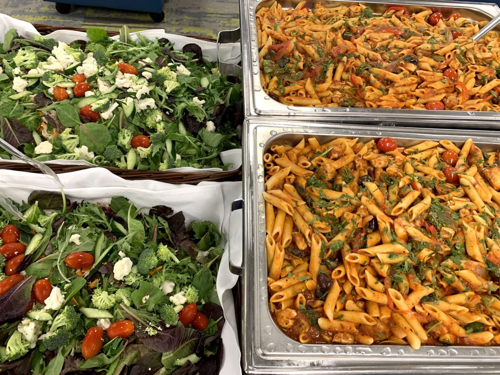 Close-up of fresh salad and penne pasta dinner from Potluck Cafe