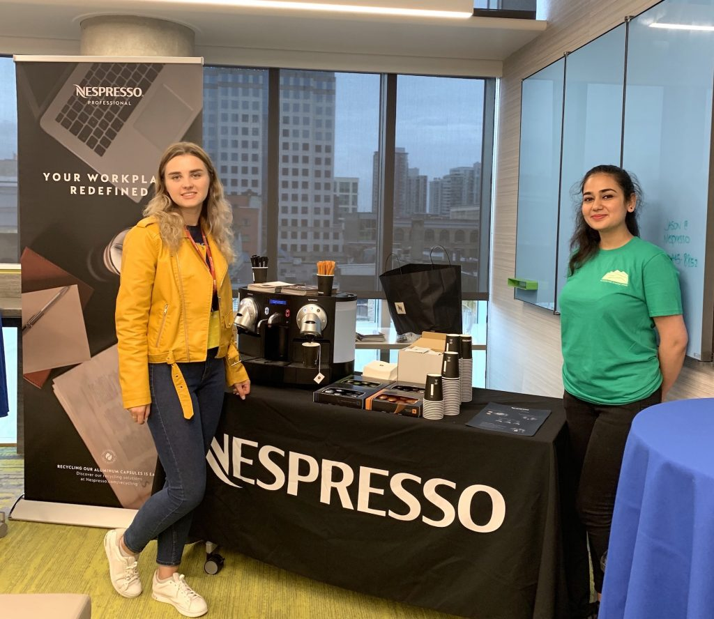 CTO.ai representative and a VSW volunteer standing next to Nespresso machine