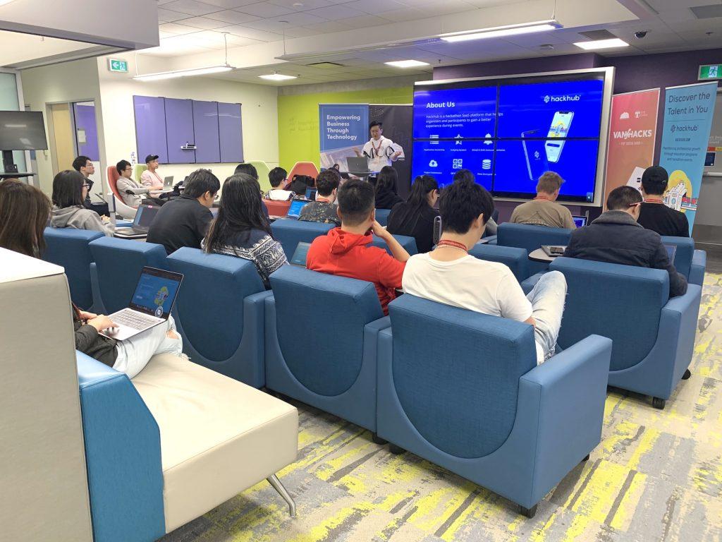 Yan presenting HackHub workshop on big screen