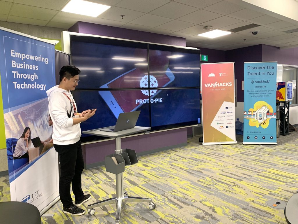 Yan presenting Protopie workshop at VanHacks on big screen