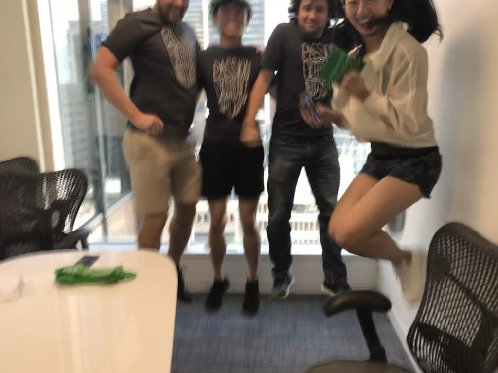 Scavenger hunt photo of team green members jumping in the air
