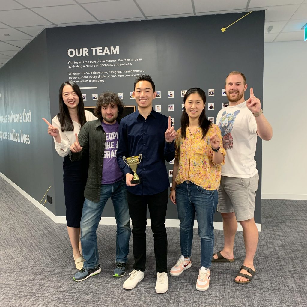 The green team, winners of the 2019 TTT Scavenger Hunt, poses with the champion's trophy
