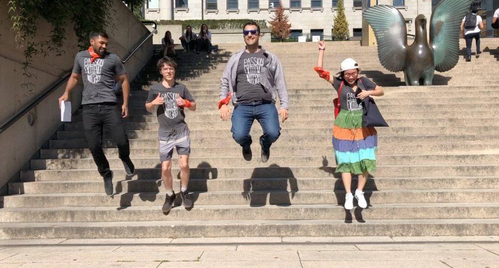 Scavenger hunt photo of team orange members jumping in the air