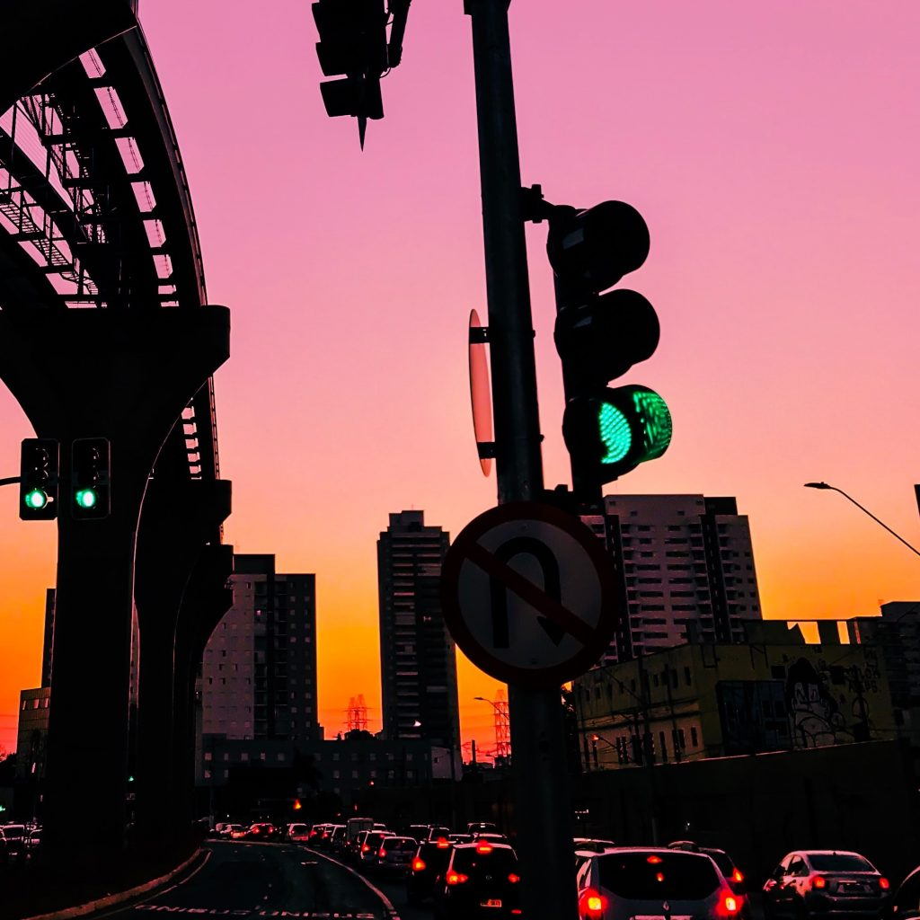 picture of a green traffic light with sunset in background