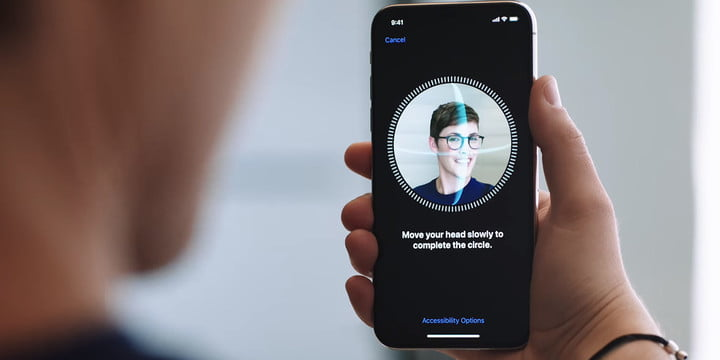 An iPhone user scanning their face in order to use Apple's Face ID.