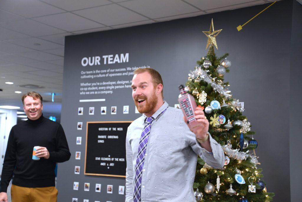 Mitch Ganton receiving a gift at TTT's 2019 Christmas gift exchange