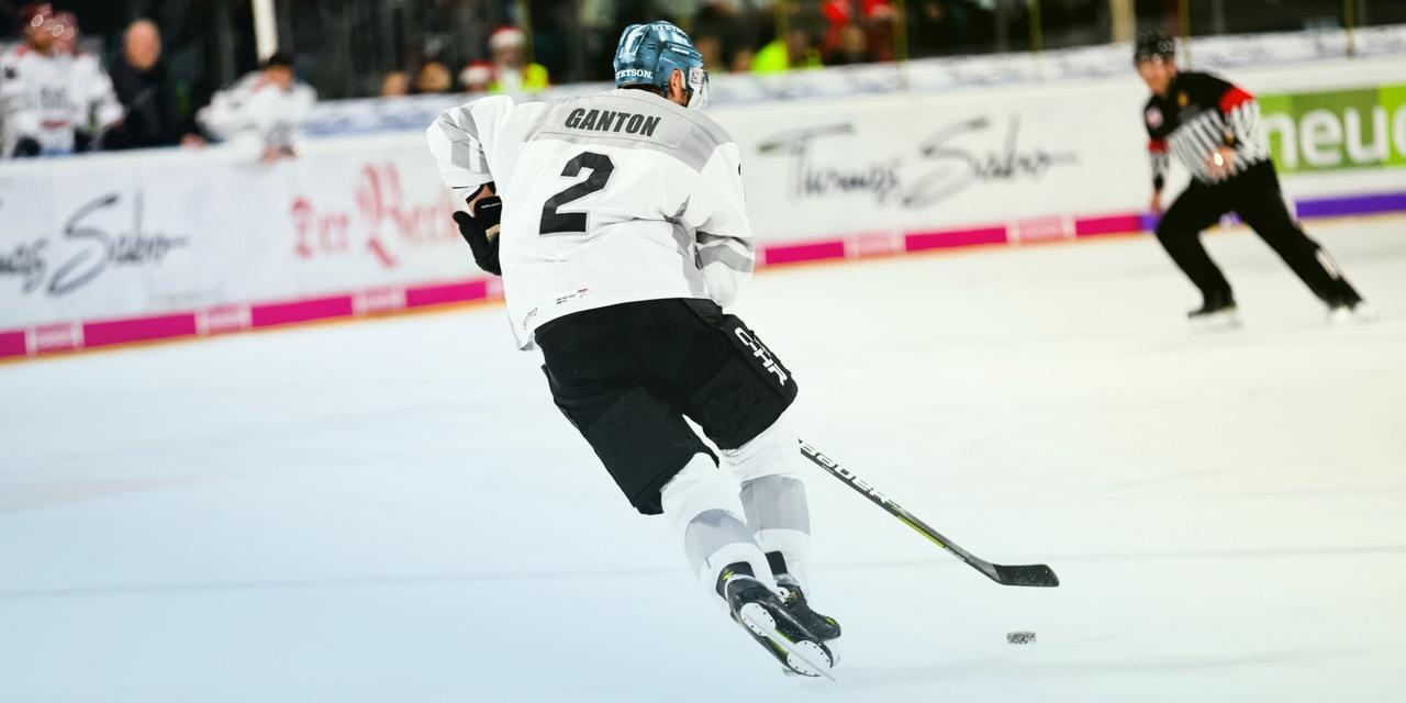 """Ganton"" playing hockey in an ice rink"