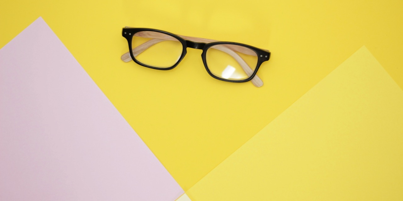 glasses on yellow paper